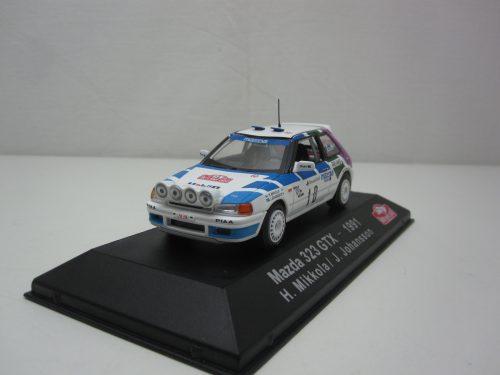 Mazda_323_GTX_1991_#10_Monte_Carlo_Rally_Mikkola_Johansson_atl3575028_Jagersma_Miniaturen_Modelauto's